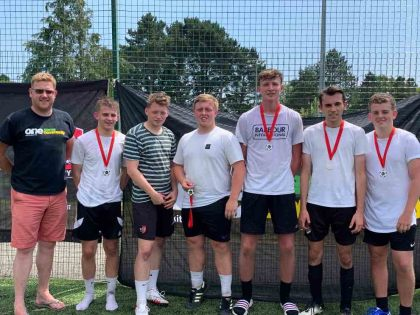 The Saints were runners-up in the Exeter City FC One Game One Community Group community diversity football tournament, with Simon Kitchen from ECFC OGOC group, left. Photo: Alan Quick