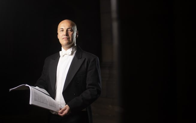 Exeter Philharmonic Choir's conductor Howard Ionascu