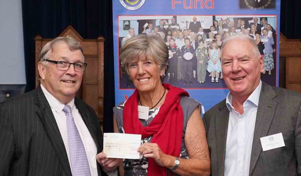 "Jill Diprose receiving the cheque"" from Ian Kingsbury accompanied by Bob Buckley of St. Michaels Lodge."
