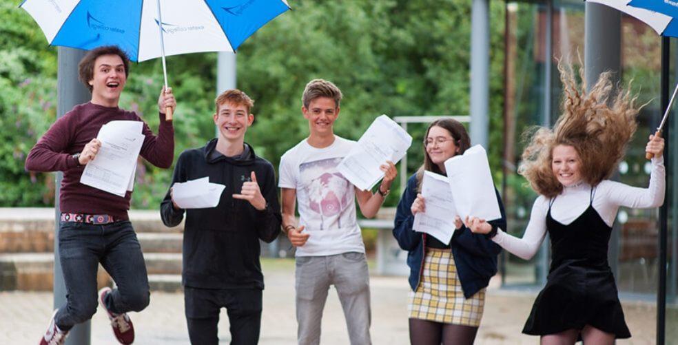 students celebrating exam result success