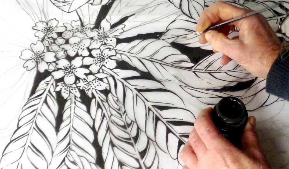 Caroline Hall Guild Member drawing a textile pattern