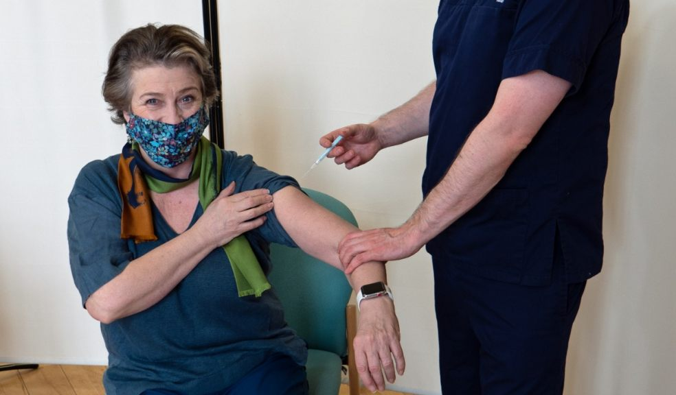 Dr Jon Williams of Amicus Health gives Caroline Quentin her vaccine