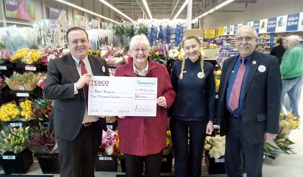 Dan Salisbury, customer service manager at the Exeter Vale Tesco Extra, presents a cheque for £4,000 to Pete's Dragons chair of trustees Janet Ash. Also pictured are Tesco's Marta Marsweska and John Smith.