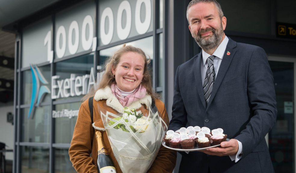 Exeter Airport managing director Matt Roach with millionth passenger Lily Harris.