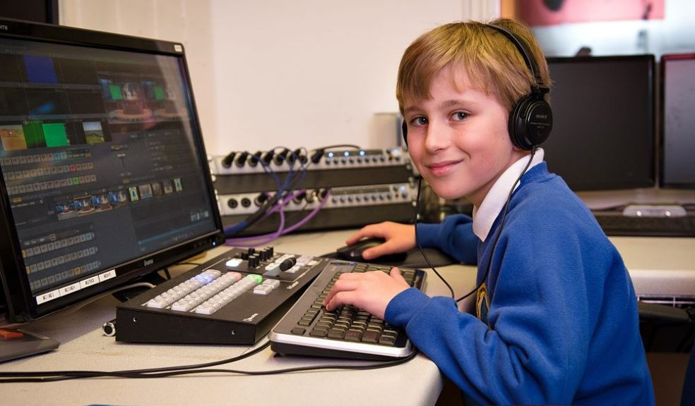 Year 4 BCPS student using desktop computer and headphones