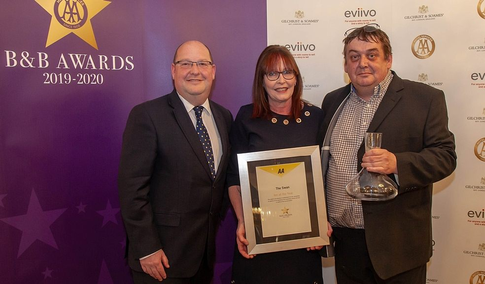 Paul and Donna Berry of the award-winning Swan in Bampton, which has won the AA's 'Inn of the Year' award 2019-20, receiving their award from Paul Hackett Senior Inspector from the AA (left).