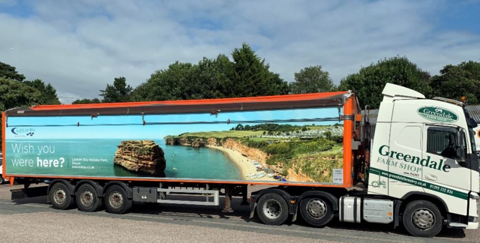 """Can you see the sea yet? Even far inland, the answer's """"yes"""" thanks to this giant postcard from Ladram Bay"""