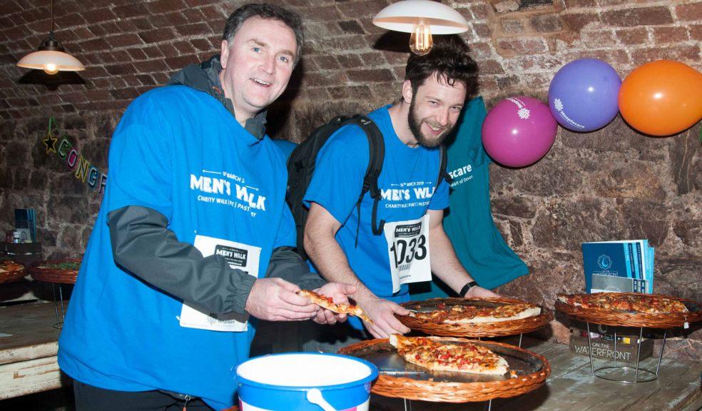 Men's Walk participants in Hospiscare t-shirts enjoy a pizza en route