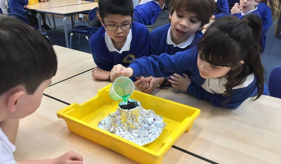 Children from the school experimenting with a foil 'volcano'