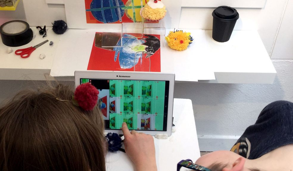 Kids filming hand made pom poms at Devon Guild