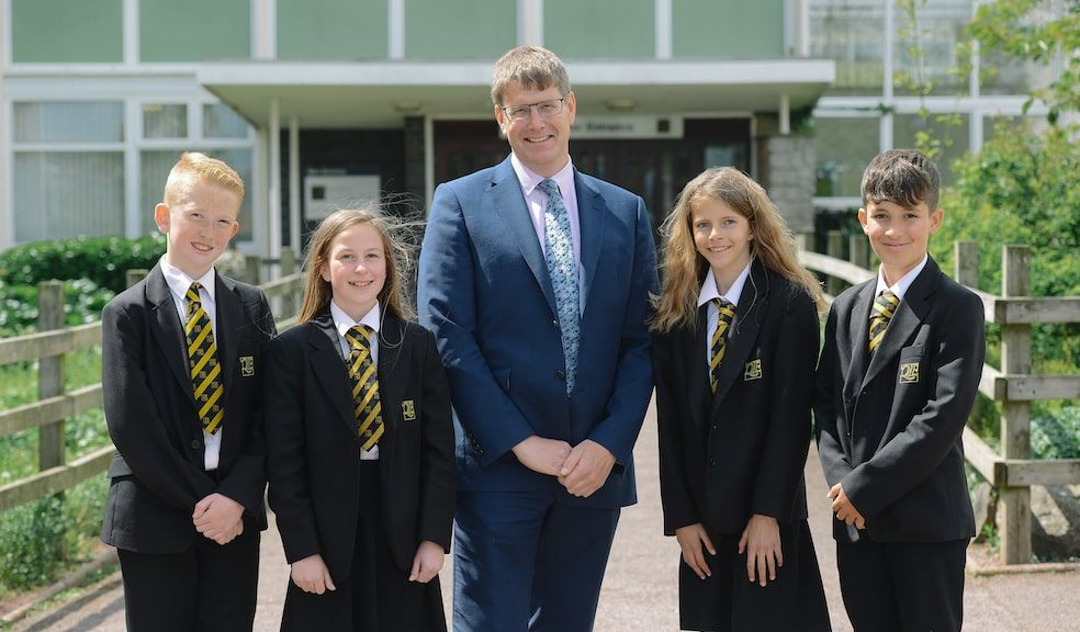 Headteacher Rupert Poole with students from Queen Elizabeth's School