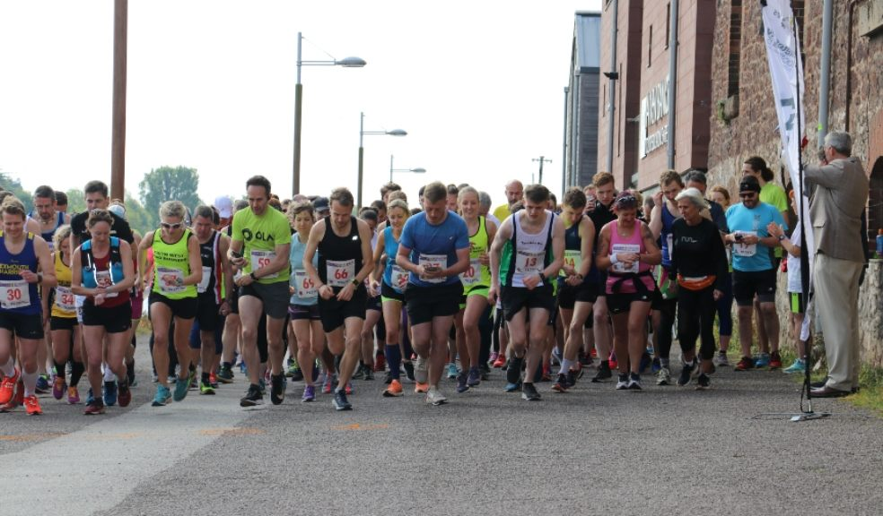 Marathon runners get ready to race at Exeter Quayside