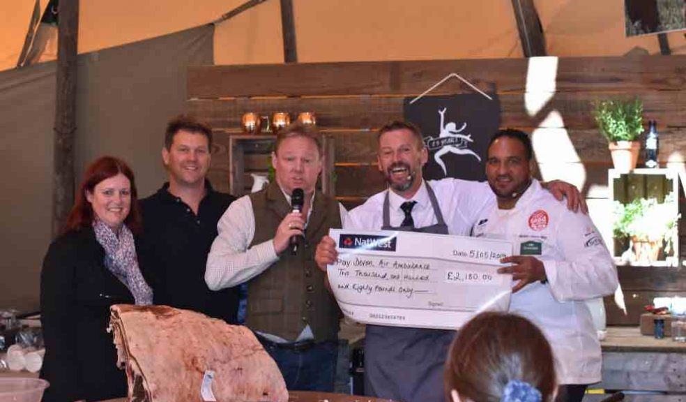 L-R: Caroline Creer, Fundraising and Communications Director at Devon Air Ambulance; James Dart, Co-Owner of Darts Farm; David FitzGerald, BBC Radio Devon Presenter; Alastair David, Master Butcher at The Butchers at Darts Farm; Michael Caines MBE, Head Chef at Gidleigh Park. The cheque for the sums raised from the sale of last year's winning sausage is presented to Caroline on behalf od Devon Air Ambulance.