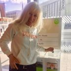 Lynne Barker-Privalova, one of Pete's Dragons' counsellors, votes with her green token as part of the John Lewis Community Matters scheme.