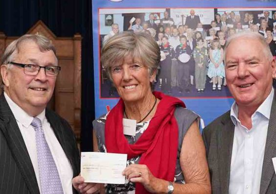 """Jill Diprose receiving the cheque"""" from Ian Kingsbury accompanied by Bob Buckley of St. Michaels Lodge."""