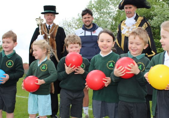 Children from Trinity C of E Primary School are pictured with (L-R) Senior Mace Sergeant John Davies; Dominic Goodhew, CITY Community Trust PL Primary Stars coach; and the new Lord Mayor of Exeter Cllr Peter Holland