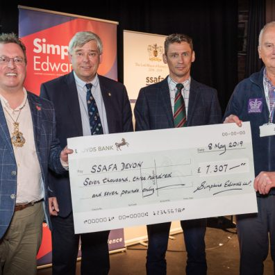 Lord Mayor of Exeter, Councillor Rob Hannaford, John Coombs and Jean-Paul Quertier, partners at Simpkins Edwards, presenting Brigadier Andy Pillar OBE and Chairman of SSFA, Devon Branch with a Really Big Quiz cheque for over £7,000