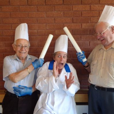 Cadogan Court residents Peter Lawry (left) and Ted Forward (right) lark about with the Home's Activities Coordinator Luan Phillips.