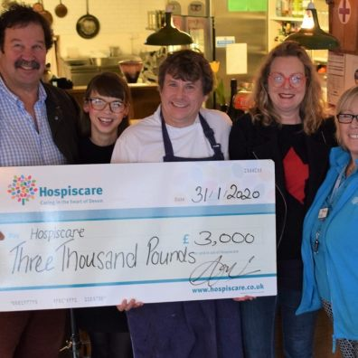 People holding a cheque