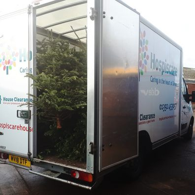 Hospiscare van being loaded with Christmas Trees