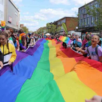 One of the two rainbow flags making their way towards Exeter High Street. Photo: Alan Quick