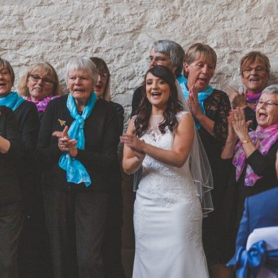 Rachel singing with the Hospiscare Choir at her wedding