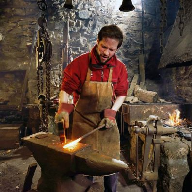 Shaping metal on the anvil. Photo: John Millar, National Trust Images