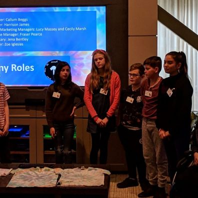 The Broadclyst team show their t-shirt samples at the presentation in Microsoft HQ, Seattle