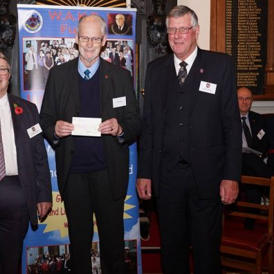 Peter Holman receiving the cheque from Ian Kingsbury accompanied by W. Bro. Clive Eden from St. Michaels Lodge in Dawlish.