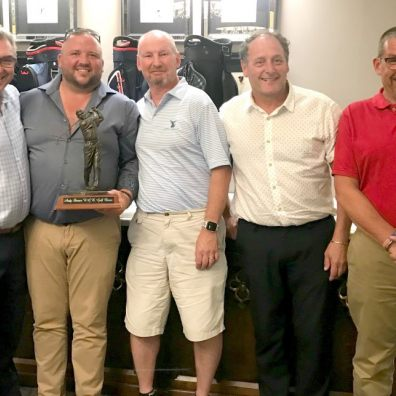 The team from The Room Works being presented with the Andy Shinner Trophy from RGB Building Supplies' CEO Kevin Fenlon. From LtoR: Kevin Fenlon, Dean Clarke, Jim Leisk, Mike Jordan and Will Smith